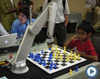 image of chess playing robot