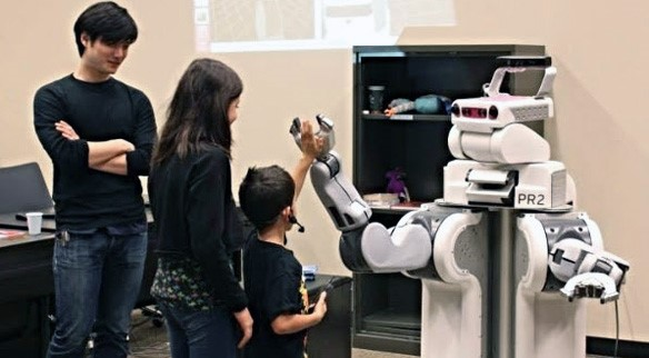 Middle school students interacting with robot